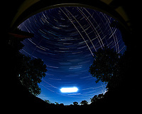 Star trails over New Jersey. Composite of images (22:30 to 23:29) taken with a Nikon D850 camera and 8-15 mm fisheye lens (ISO 100, 8 mm, f/4, 30 sec). Raw images processed with Capture One Pro, and the composite generated using Photoshop CC (statistics, maximum).