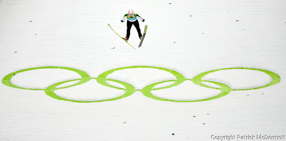 David Lazzaroni of France flies through the air in the Men's Ski Jumping Normal Hill during the 2010 Vancouver Winter Olympics at the Whistler Olympic Park in Whistler, Canada, on Feb. 13, 2010.