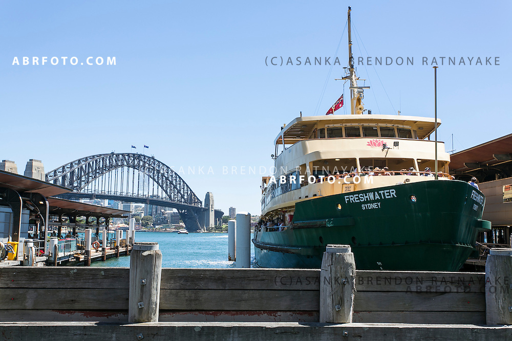 Sydney Harbour Ferry service dock with Sydney Harbour Bridge in the background