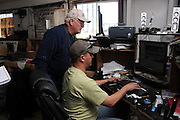 Glenn Spencer, (left), and Michael King of the American Border Patrol, Hereford, Arizona, USA, watch a monitor connected to a high powered camera.  Spencer monitors smuggling activity along the U.S./Mexico border.