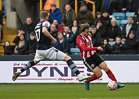 Football - 2019 / 2020 Emirates FA Cup - Fourth Round: Millwall vs. Sheffield United<br /> <br /> Luke Freeman (Sheffield United) wrong foots James Brown (Millwall FC) at The Den.<br /> <br /> COLORSPORT/DANIEL BEARHAM
