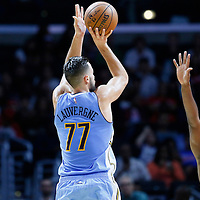 02 October 2015: Denver Nuggets forward Joffrey Lauvergne (77) takes a jump shot over Los Angeles Clippers forward Luc Richard Mbah a Moute (12) during the Los Angeles Clippers 103-96 victory over the Denver Nuggets, in a preseason game, at the Staples Center, Los Angeles, California, USA.