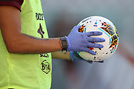 A ballboy holds a match ball wearing protective gloves during the Serie A match at Stadio Grande Torino, Turin. Picture date: 20th June 2020. Picture credit should read: Jonathan Moscrop/Sportimage