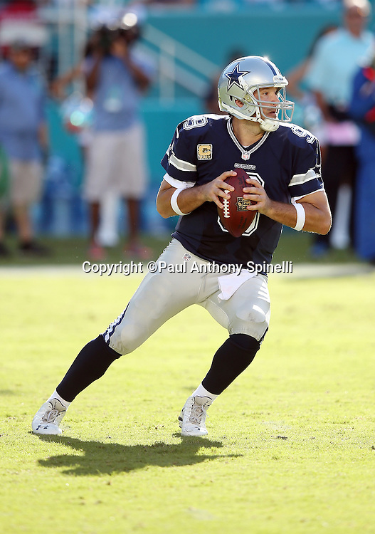 Dallas Cowboys quarterback Tony Romo (9) drops back to pass during the 2015 week 11 regular season NFL football game against the Miami Dolphins on Sunday, Nov. 22, 2015 in Miami Gardens, Fla. The Cowboys won the game 24-14. (©Paul Anthony Spinelli)