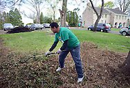 Azim Lavingia of Bensalem, Pennsylvania rakes weeds at Three Arches as part of the 14th annual Comcast Cares Day Saturday April 25, 2015 Falls Township, Pennsylvania. (Photo by William Thomas Cain/Cain Images)