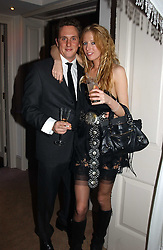 HARRY BECHER and the HON.SOPHIA HESKETH at a party to celebrate the 4th anniversary of Quintessentially held at 11 Grosvenor Place, London  SW1 on 14th December 2004.<br />