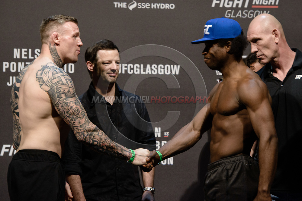 "GLASGOW, UNITED KINGDOM, JULY 15, 2017: Charlie Ward faces off against Galore Bofando on stage during the ceremonial weigh-in for ""UFC Fight Night Glasgow: Nelson vs. Ponzinibbio"" inside the SSE Hydro Arena in Glasgow"