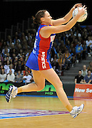 Megan Dehn reaches for the ball for the Mystics ~ Netball action from ANZ Championship Grand Final - Queensland Firebirds v Northern Mystics - played at the Brisbane Convention Centre on Sunday 22nd May 2011 ~ Photo : Steven Hight (AURA Images) / Photosport