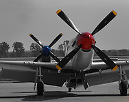 Two P-51 Mustangs rest before the next flight