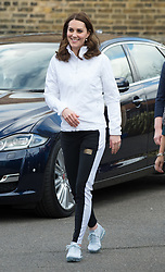 Catherine, Duchess of Cambridge, wearing a black and white tracksuit, visits Bond Primary School in London to see the work of the Wimbledon Junior Tennis Initiative