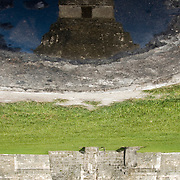 The Great Pyramid of Tikal is reflected in a ceremolnial alter that stands in front of all pyramids in Tikal.  As many as 120,000 people once lived here and in the surrounding area.  Tikal, Guatemala, July 2009.  (Photo/William Byrne Drumm)
