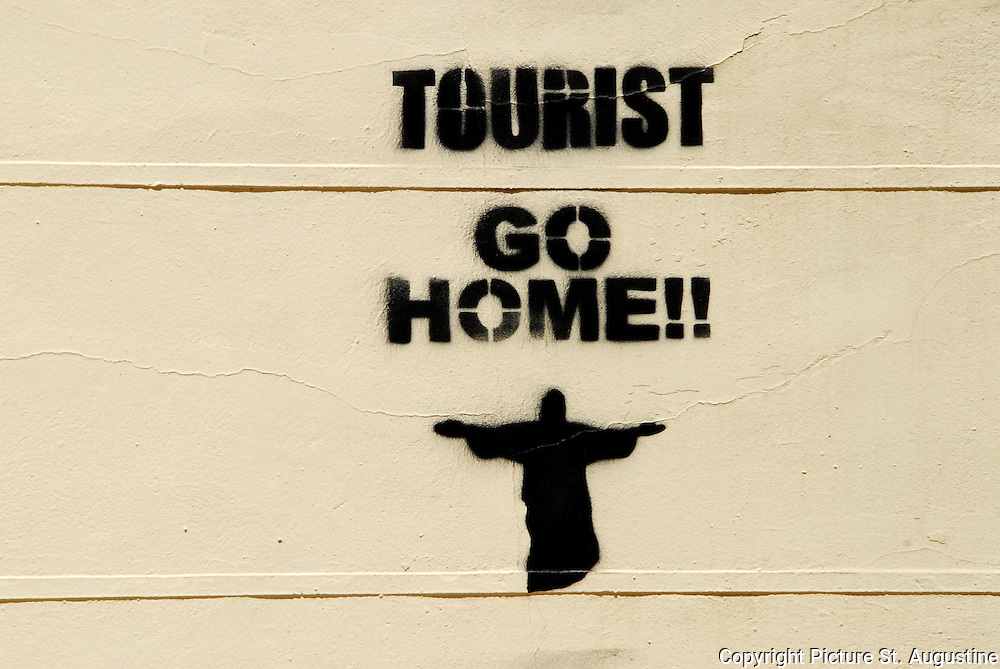 Tourist go Home!! This stencil was spray painted on buildings throughout a small town in Spain.