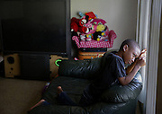 Noah Muhammad, 8, sheds a tear after his mother Fatin Muhammad told him that he was not allowed to play outside Wednesday at their home in the West Calumet Housing Complex in East Chicago. Muhammad has not allowed her children to play outside since she was told about high lead level in their soil.