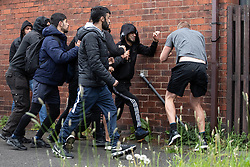 © Licensed to London News Pictures . 18/05/2019. Oldham, UK. Men fighting as the rally takes place . Former EDL leader Stephen Yaxley-Lennon (aka Tommy Robinson ) continues his campaign for a seat in the European Parliament representing the North West of England , by visiting Oldham . Photo credit: Joel Goodman/LNP