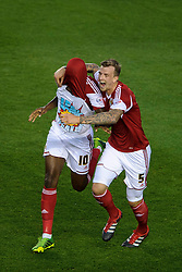 """Bristol City Midfielder Jay Emmanuel-Thomas (ENG) celebrates scoring a goal with Defender Aden Flint (ENG) by revealing a tshirt that reads """"leave it yeah!"""" during the first half of the match - Photo mandatory by-line: Rogan Thomson/JMP - Tel: 07966 386802 - 04/09/2013 - SPORT - FOOTBALL - Ashton Gate, Bristol - Bristol City v Bristol Rovers - Johnstone's Paint Trophy - First Round - Bristol Derby"""
