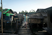 Here, in Shwe Thaung Yan, where the poorest can not afford land, they live on the water, in stilt houses connected by broken bridges.