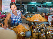 20 APRIL 2015 - BANGKOK, THAILAND:  A woman sells dried shrimp in Talat Phlu, a market in the Thonburi section of Bangkok.    PHOTO BY JACK KURTZ