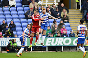 Reading FC defender Paul McShane wins the header ahead of Cardiff City midfielder Anthony Pilkington during the Sky Bet Championship match between Reading and Cardiff City at the Madejski Stadium, Reading, England on 19 March 2016. Photo by Mark Davies.