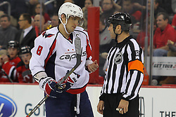 Jan 25, 2013; Newark, NJ, USA; Washington Capitals left wing Alex Ovechkin (8) talks to referee Justin St. Pierre (12) during the second period at the Prudential Center.