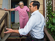 14 JUNE 2019 - WAUKEE, IOWA: JULIÁN CASTRO, right, Democratic presidential candidate and former Secretary of Housing and Urban Development during the Obama administration, talks to ARLETA SWAIN, 92 years old, a resident of Midwest County Estates, a mobile home community in Waukee, a suburb of Des Moines, Friday. Castro met with residents in the community to talk about affordable housing. Mobile County Estates was sold in March and the new owners are trying to hike rents for lots in the community by 69%, an amount residents say they can't afford. Swain was one of the first people to move into Midwest County Estates. She's been living in the mobile home park since it opened in 1969. Castro is visiting Iowa to support his candidacy for the Democratic ticket of the US Presidency. Iowa traditionally hosts the the first selection event of the presidential election cycle. The Iowa Caucuses will be on Feb. 3, 2020.                                  PHOTO BY JACK KURTZ