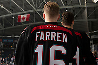 KELOWNA, CANADA - OCTOBER 13: Michael Farren #16 of the Kelowna Rockets stands on the bench during the national anthem against the Tri-City Americans on October 13, 2018 at Prospera Place in Kelowna, British Columbia, Canada.  (Photo by Marissa Baecker/Shoot the Breeze)  *** Local Caption ***