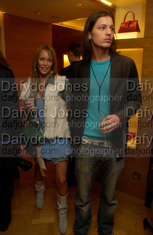 Ellie Shepherd and Lee Craig, Burberry party to launch collection in  support of Breakthrough Breast Cancer. New Bond St. shop. Londddon. 5 October 22004. ONE TIME USE ONLY - DO NOT ARCHIVE  © Copyright Photograph by Dafydd Jones 66 Stockwell Park Rd. London SW9 0DA Tel 020 7733 0108 www.dafjones.com