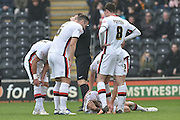 Milton Keynes Dons defender Kyle McFadzean(5) sustains an injury  during the Sky Bet Championship match between Hull City and Milton Keynes Dons at the KC Stadium, Kingston upon Hull, England on 12 March 2016. Photo by Ian Lyall.