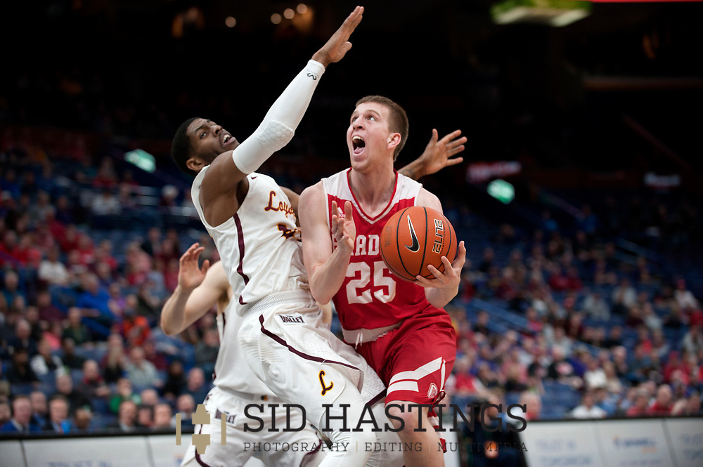 Loyola University Chicago basketball player Aundre Jackson (24) defends against Bradley University's Nate Kennell (25) during the semifinals of the Missouri Valley Conference men's basketball tournament at Scottrade Center in St. Louis Saturday, March 3, 2018. LUC won, 62-54. Photo © copyright 2018 Sid Hastings.