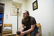 Feb.4 2014 - New York, NY. Mat Oelke, 28, is a volunteer working in the St. Anthony Shelter for Renewal in the South Bronx.02/04/2014 Photograph by Qingqing Chen/NYCity Photo Wire