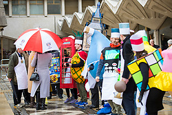© Licensed to London News Pictures. 13/02/2018. London, UK. The novelty dress competition is judged at the annual Inter-Livery Pancake Race at Guildhall Yard in the City of London. The race component of the event had to be abandoned owing to bad weather. Photo credit: Rob Pinney/LNP