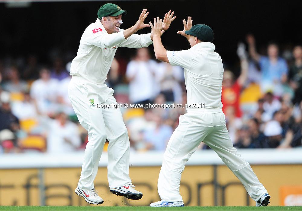 Michael Hussey celebrates the dismissal of Jesse Ryder, caught by David Warner on Day 1 of the first cricket test between Australia and New Zealand Black Caps at the Gabba in Brisbane, Thursday 1 December 2011. Photo: Andrew Cornaga/Photosport.co.nz