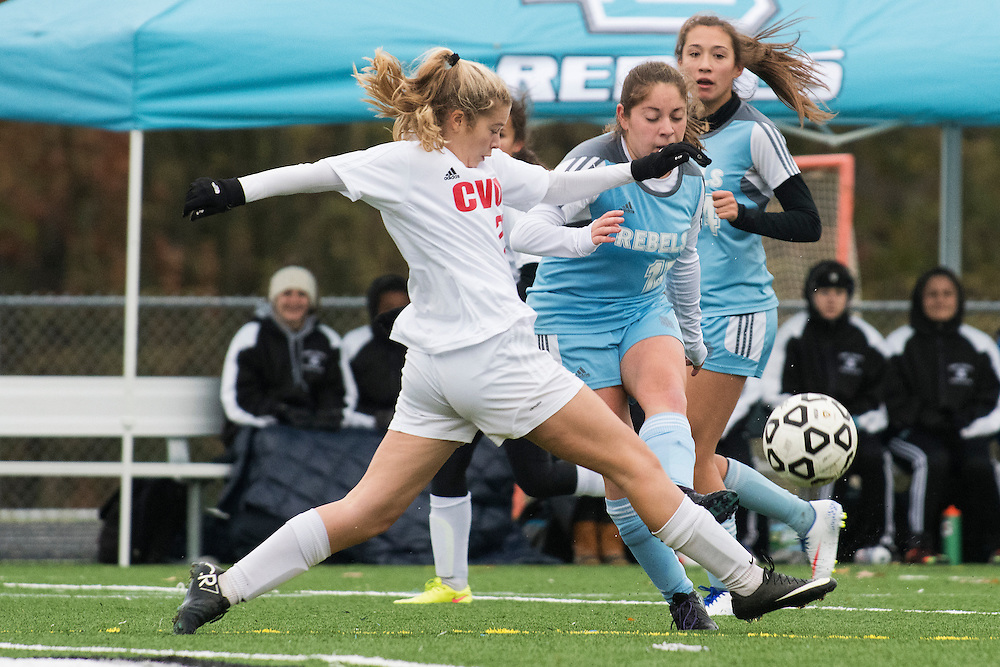 CVU's Signy Shumway (3) kicks the ball during the girls high school playoff game between the Champlain Valley Union Redhawks and the South Burlington Rebels at South Burlington High School on Saturday afternoon October 29, 2016 in South Burlington. (BRIAN JENKINS/for the FREE PRESS)
