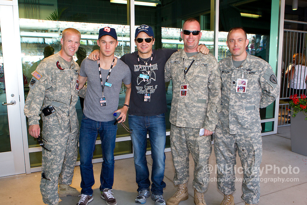 Brian Geraghty and Jeremy Renner seen with members of the military at the Indy 500.<br /> Photo by Michael Hickey