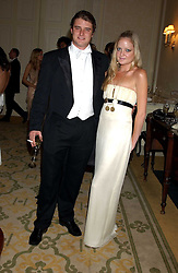 LADY ELOISE ANSON and CHARLES BEAMISH at a dinner hosed by Moet & Chandon at their headquarters at 13 Grosvenor Crescent, London on 12th October 2005.<br />