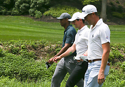 August 9, 2018 - St. Louis, Missouri, United States - (L-R) Tiger Woods, Rory McIlroy and Justin Thomas walk off the 8h tee during the first round of the 100th PGA Championship at Bellerive Country Club. (Credit Image: © Debby Wong via ZUMA Wire)