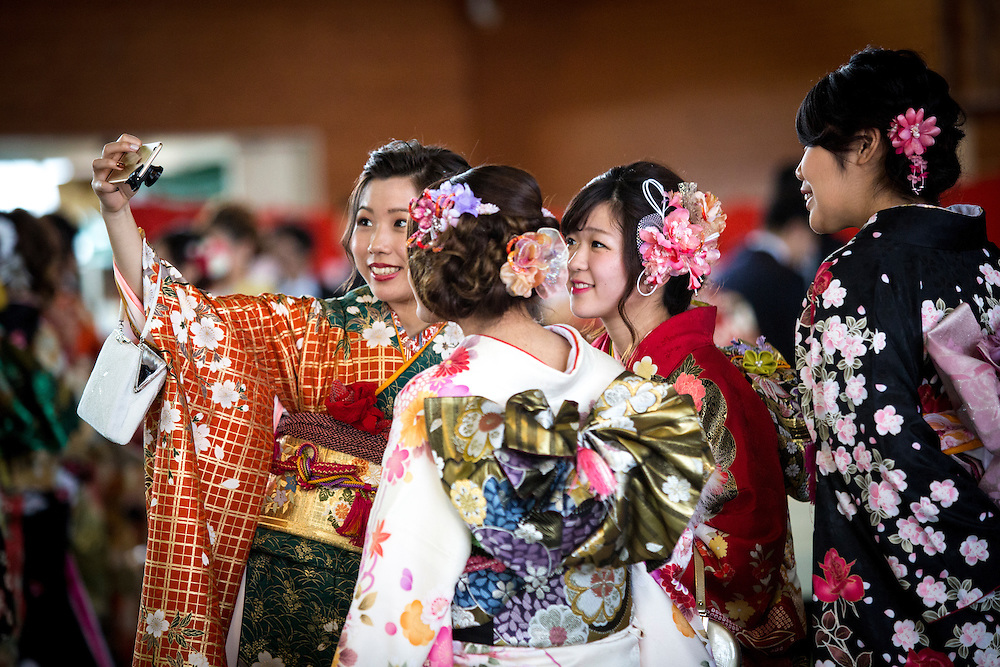 OKINAWA, JAPAN - JANUARY 8 : New adults in kimonos takes selfies after attending a Coming of Age Day celebration ceremony in Shuri Junior High School in Okinawa, Japan on January 8, 2017. The Coming of Age Day, one of the Japanese national holidays, is the day to celebrate young people who have reached the age of 20, the age of maturity in Japan, when they are legally permitted to smoke, drink alcohol and vote. (Photo by Richard Atrero de Guzman/NURPhoto)