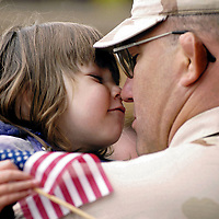 Sarah Lunson gets an Eskimo-kiss from her dad, Cpl. Eric Lunson, upon his return from Iraq. Lunson and about 100 of his fellow Marines returned to Marine Corps Air Station Yuma early Monday morning.