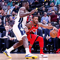 01 November 2017: Toronto Raptors forward Norman Powell (24) drives past Denver Nuggets forward Paul Millsap (4) during the Denver Nuggets 129-111 victory over the Toronto Raptors, at the Pepsi Center, Denver, Colorado, USA.