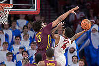 FAYETTEVILLE, AR - DECEMBER 9:  Jordan Murphy #3 of the Minnesota Golden Gophers goes up to block the shot of Daryl Macon #4 of the Arkansas Razorbacks at Bud Walton Arena on December 9, 2017 in Fayetteville, Arkansas.  The Razorbacks defeated the Golden Gophers 95-79.  (Photo by Wesley Hitt/Getty Images) *** Local Caption *** Jordan Murphy; Daryl Macon