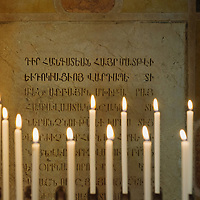 VENICE, ITALY - AUGUST 14: Candle are lit in front of an armenian inscription at the monastery of San Lazzaro on August 14, 2011 in Venice, Italy. The Armenian Monastery is based on San Lazzaro which is a small island in the Venetian Lagoon lying immediately west of the Lido it is completely occupied by the monastery, founded around 1707, is the mother-house of the Mekhitarist Order, the island is one of the world's foremost centers of Armenian culture
