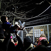 Greece - Idomeni Nights /<br /> <br /> On the Greek-Macedonian border the Idomeni refugee camp at its peak sheltered 13,000 refugees and migrants. With the closure of the &ldquo;Balkan route&rdquo; and no information from EU countries, families from war-torn countries such as Syria, Iraq and Afghanistan settled-in. <br /> <br /> As the refugee bottle-neck grew the squalid conditions lead to frustration and protests while the spring rains turned the fields into mud.