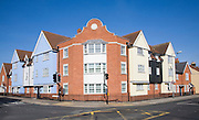 Urban infilling of new buildings in traditional style on road corner plot, Colchester town centre, Essex, England