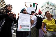 Frankfurt am Main | 24 July 2014<br /> <br /> Am Donnerstag (24.07.2014) demonstrierten etwa 150 Menschen aus linksradikalen und migrantischen Zusammenh&auml;ngen in Frankfurt am Main auf der Einkaufsstra&szlig;e Zeil gegen die israelischen Angriffe auf Pal&auml;stina und Gaza.<br /> Hier: Eine junge Muslima mit einem Plakat mit der Aufschrift &quot;Jesus was Palestinian&quot;.<br /> <br /> Photo &copy; peter-juelich.com