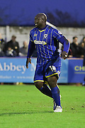 Bayo Akinfenwa of AFC Wimbledon in action during the Sky Bet League 2 match between AFC Wimbledon and Stevenage at the Cherry Red Records Stadium, Kingston, England on 12 December 2015. Photo by Stuart Butcher.