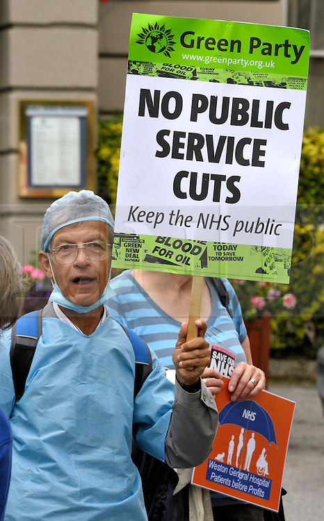 &copy; Licensed to London News Pictures. 13/09/2013. Weston-super-Mare, Somerset, UK. A demonstration against cuts and privatisation of the NHS, outside the Royal Hotel in Weston-super-Mare during a visit for a private function by Health Secretary Jeremy Hunt who went in through a side entrance avoiding the protest.  The protesters say that Weston General Hospital is in danger of being franchised out to multi-nationals as the local health trust has suffered financial difficulties.  13 September 2013.<br /> Photo credit : Simon Chapman/LNP