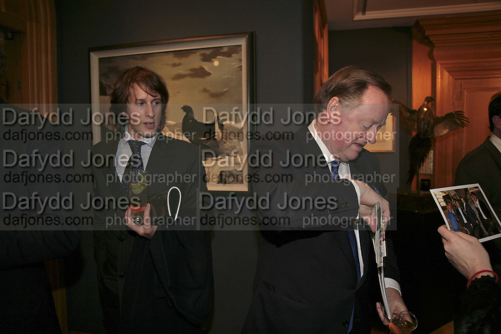 Freddie Ryder and Andrew Parker Bowles, Reception and auction of Wildlife and Sporting Art in aid of the game Conservancy Trust. Christie's. King St. London W1. 12 December 2006. ONE TIME USE ONLY - DO NOT ARCHIVE  © Copyright Photograph by Dafydd Jones 248 CLAPHAM PARK RD. LONDON SW90PZ.  Tel 020 7733 0108 www.dafjones.com
