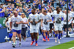 May 12, 2019 - Leicester, England, United Kingdom - Leicester City Club Ambassador Alan Birchenall runs round the pitch with Leicester City defender Wes Morgan (5), Leicester City midfielder Marc Albrighton (11) and Leicester City midfielder Demarai Gray (7) raising money for the Vichai Srivaddhanaprabha Foundation during the Premier League match between Leicester City and Chelsea at the King Power Stadium, Leicester on Sunday 12th May 2019. (Credit Image: © Mi News/NurPhoto via ZUMA Press)