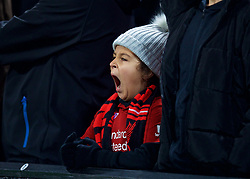 LIVERPOOL, ENGLAND - Tuesday, December 11, 2018: A young Liverpool supporter yawns during the UEFA Champions League Group C match between Liverpool FC and SSC Napoli at Anfield. (Pic by David Rawcliffe/Propaganda)