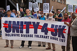 Luton, UK. 27th June, 2015. Local residents join anti-racist activists from Unite Against Fascism behind a Unity 4 UK banner to protest against a march by far-right group Britain First. A large police presence kept the two groups apart.