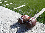 September 4 2010: Two footballs sit on the side of the field before the NCAA football game between the Eastern Illinois Panthers and the Iowa Hawkeyes at Kinnick Stadium in Iowa City, Iowa on Saturday September 4, 2010.